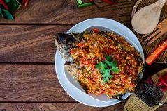 Fried Fish and Topped with Chilli Sauce stock photos