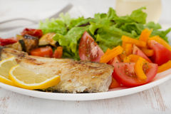Fried fish with vegetables. And salad Royalty Free Stock Photo