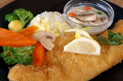 Fried fish with vegetables. And rice Stock Photos