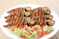 Fried fish with vegetables. Royalty Free Stock Photography