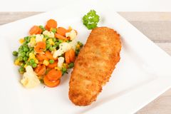 Fried fish with vegetables Royalty Free Stock Images