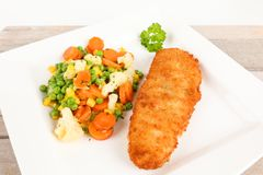 Fried fish with vegetables. On a plate Stock Photo