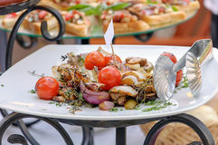Fried fish with vegetables and lemonGrilled vegetables. Grilled vegetables on a plate with bruschetta in a background Stock Photography