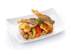 Fried fish with vegetables on a plate. Isolated on white. Restaurant food. Delicious lunch. Fried fish with vegetables on a plate. Isolated on white Royalty Free Stock Photos