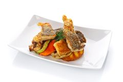 Fried fish with vegetables on a plate. Isolated on white. Restaurant food. Delicious lunch. Fried fish with vegetables on a plate. Isolated on white Royalty Free Stock Images