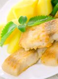 Fried fish with vegetables and potato Royalty Free Stock Photo