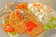 Fried fish and vegetables salad Stock Images