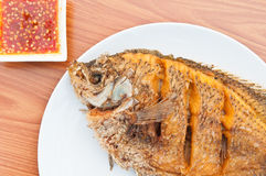 Fried fish on white dish Royalty Free Stock Photos