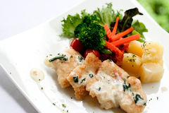 Fried fish. With white dressing sauce and boiled vegetable Stock Images