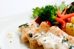 Fried fish. With white dressing sauce and boiled vegetable Royalty Free Stock Photo