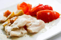Fried fish in white sauce. And tomato Royalty Free Stock Photos