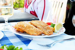 Fried fish with wine Royalty Free Stock Photography
