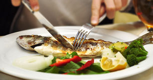 Fried Fish With A Lemon On A White Dish Royalty Free Stock Photo
