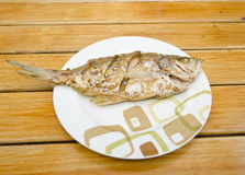 Fried fish on  wood background Stock Photo