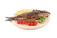 Fried fish on a wooden plate Stock Photography