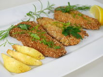 Fried fishes herrings on plate Stock Photo