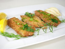 Fried fishes herrings on plate Stock Photography