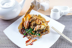 Fried flounder in Asian style Stock Images