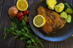 Fried flounder. Home cooking in a rustic style stock images