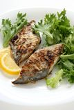 Fried flounder with lettuce Stock Photo