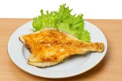 Fried Flounder on lettuce Stock Photos
