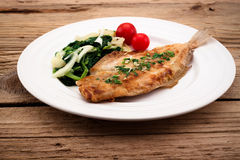 Fried flounder with onion, cabbage Stock Photo