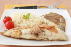 Fried flounder with rice Stock Images