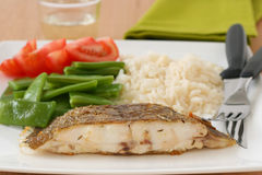 Fried flounder with rice and vegetables Royalty Free Stock Photo
