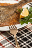 Fried flounder. Selective focus. Royalty Free Stock Image