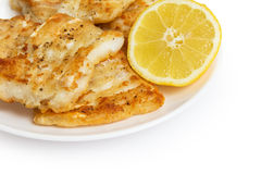 Fried in flour codfish on plate Royalty Free Stock Images