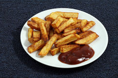Fried French fries with sauce largely Royalty Free Stock Photos