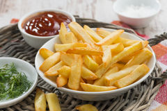 Fried french fries with tomato sauce and herbs Stock Images