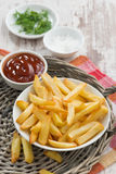 Fried french fries with tomato sauce, vertical Stock Image