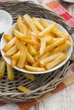 Fried french fries with tomato sauce, vertical, top view Royalty Free Stock Photo