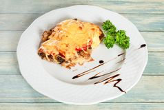 Fried french meat under cheese and vegetables stock photo