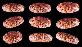 Fried fresh large beef burger isolated on white background. Grilled burger cutlet isolated on black. Set of fried fresh large beef burger isolated on white Stock Images