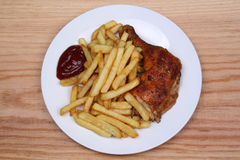 Fried fries and baked chicken leg Stock Photo
