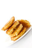 Fried fritters on a white plate Royalty Free Stock Photos