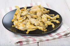 Fried frog legs Stock Photos