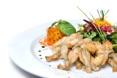 Fried frogs legs on the plate Royalty Free Stock Photo