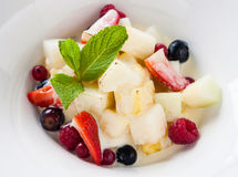 Fried fruit salad. With mint leaf in white dish Royalty Free Stock Photography