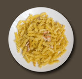 Fried Fusilli Pasta with Slices of Chicken in White Plate Stock Images