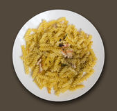 Fried Fusilli Pasta with Slices of Chicken in White Plate Royalty Free Stock Photography