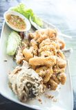 Fried Giant gourami fish  with garlic and seafood sauce, Uthai T Stock Photo