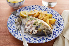 Fried gilt head bream with potatoes Royalty Free Stock Photos