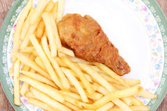 Fried golden chicken leg with french fries Stock Image