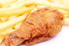 Fried golden chicken leg with french fries Royalty Free Stock Photos