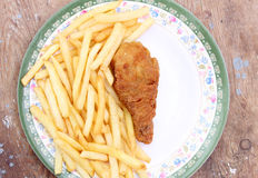 Fried golden chicken leg with french fries Royalty Free Stock Photo