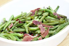 Fried green beans with ham Stock Images
