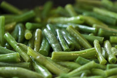 Fried green beans in olive oil. Fried green beans with olive oil close-up Royalty Free Stock Photography